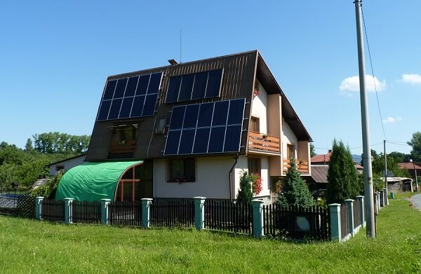 house with solar hot water heater