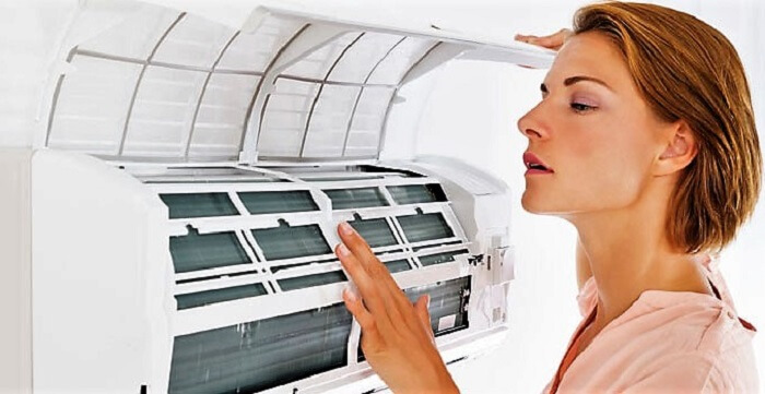 Woman checking the AC