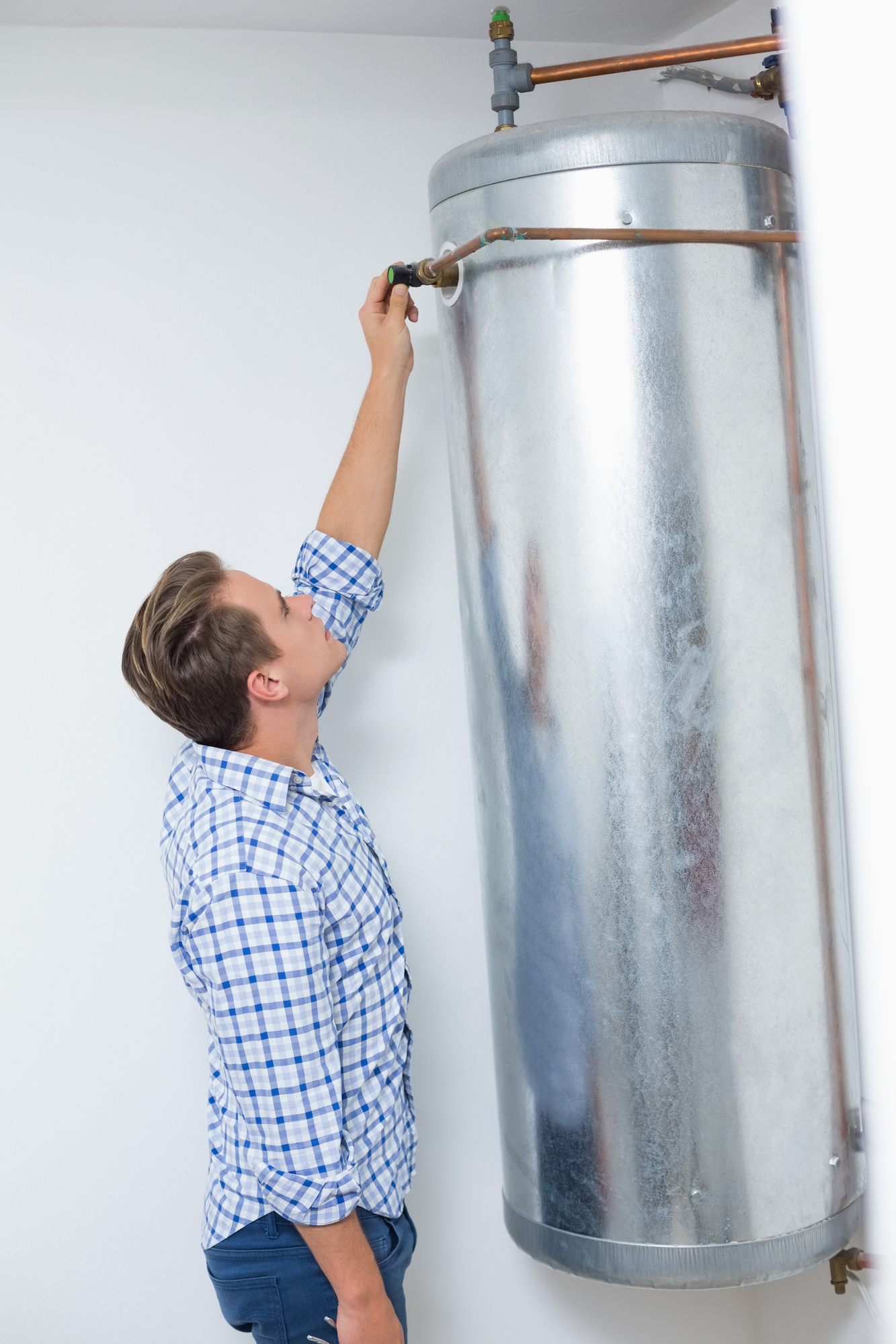 Technician servicing a hot water heater