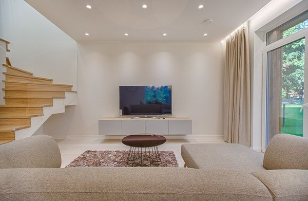 white walled room with tv